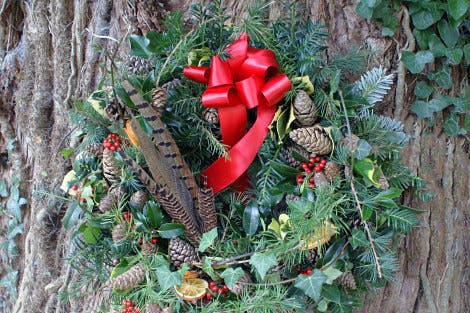 Victorian-style wreath hanging on a tree in the gardens at Hillsborough Castle