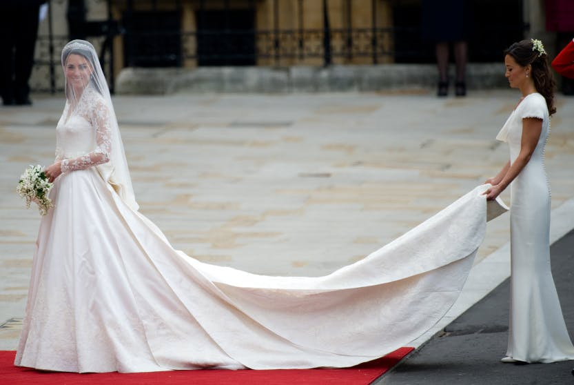 Kate Middleton waves as she arrives with her sister, the Maid of Honour Philippa Middleton at Westminster Abbey in London for her wedding to Britain's Prince William, on April 29, 2011.