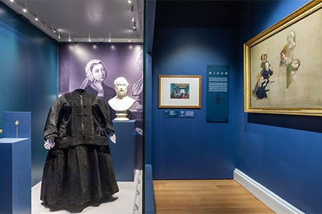 Room 3 displaying items including a black dress worn by Victoria during mourning of the death of Prince Albert.