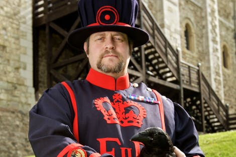 Ravenmaster Chris Skaife holds one of the Tower ravens outside the White Tower