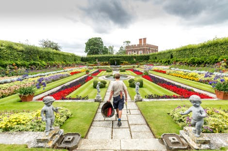 The Pond Gardens, looking south. Showing a member of the Garden and Estates team carrying  gardening equipment.