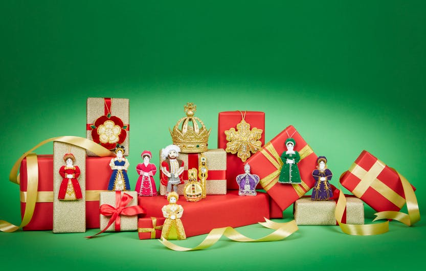 Christmas gifts and hanging decorations on a bright green background.