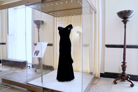 Midnight Blue dress on display in glass cabinet