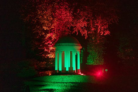 View of Hillsborough Castle gardens lit with colourful lights at night