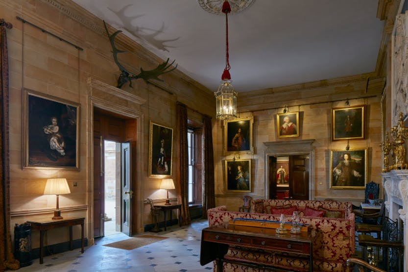 State Entrance Hall at Hillsborough Castle with artworks hanging on the walls.