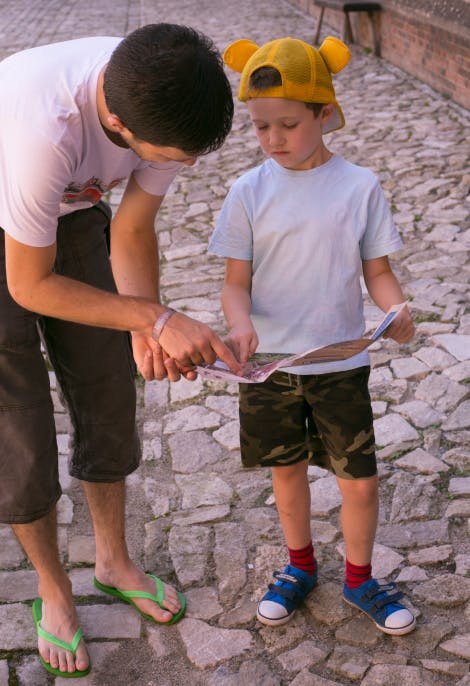 A family exploring Hampton Court Palace with a family trail