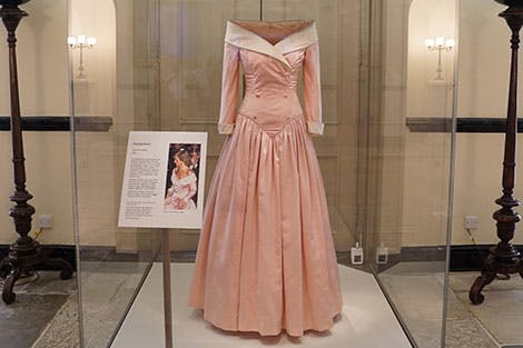 A pink evening gown from the wardrobe of Diana, Princess of Wales, on display in a gallery at Kensington Palace