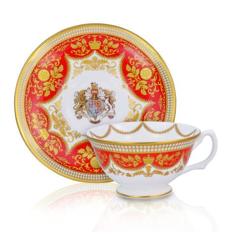 This regal red fine bone china teacup and saucer features Queen Anne's crest. Made in the UK exclusively for Historic Royal Palaces.