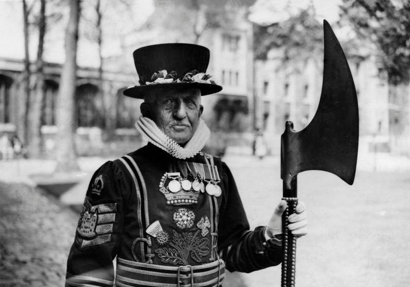 Black and white photograph of Yeoman Warder John Fraser at the Tower of London.