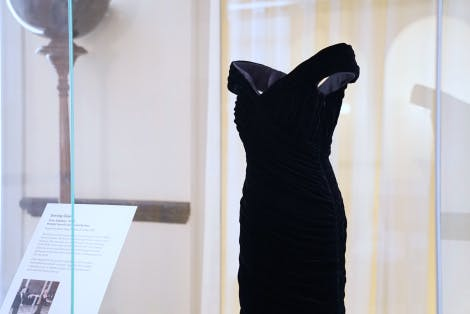 Close up of Midnight Blue dress on display in glass cabinet