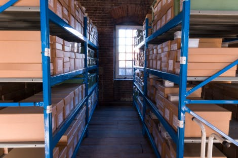 Apartment 16, showing Historic Royal Palaces collections storage at the end of a 2014-16 collections review project. Showing labelled archive boxes stacked on open metal shelving.  Part of a visual diary documenting the cataloguing and collections review project 2014-16.