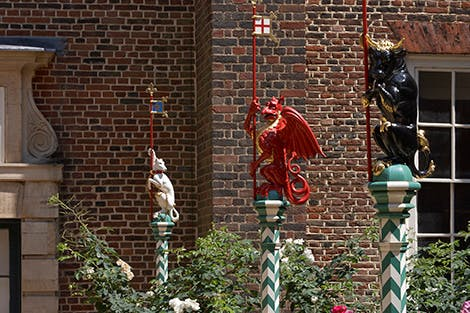 A display of brightly coloured heraldic beasts in Chapel Court