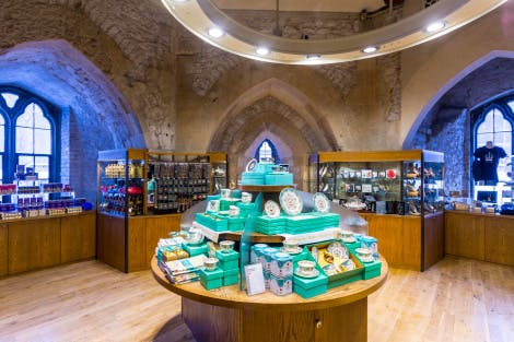 The Jewel House Shop, looking north-east towards a display of Royal Palace Collection tea and bone china tea-sets merchandise. More display stands of merchandise can be seen in the background.