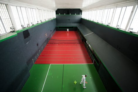 A match in progress in the Royal Tennis Court Built in the reign of King Charles I and remodelled in the reign of Charles II, the tennis court is still is use today and is the venue for the British Open Real Tennis Championships