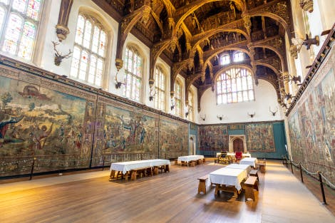 The Tudor Great Hall at Hampton Court Palace, showing the Abraham Tapestries and the room set out for day visitors.