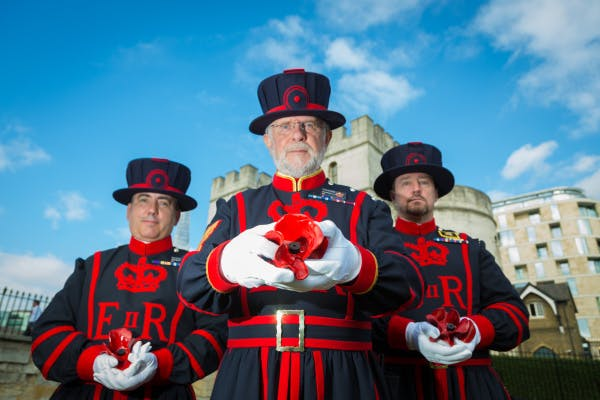 On 17 July 2014, Yeoman Serjeant Crawford Butler, then Tower of London's longest serving Yeoman Warder, planted the first of over 800,000 ceramic poppies that appeared around the famous landmark over the summer of 2014 to form a major art installation marking the centenary of the First World War. Yeoman Serjeant Crawford Butler with Yeomen Warders John Donald and Andrew Merry, each holding a ceramic poppy.