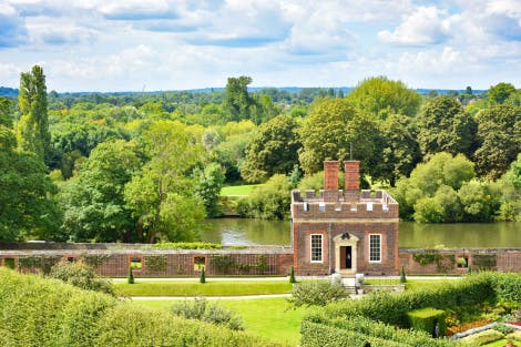 The historic baroque building known as Little Banqueting House situated in the gardens at Hampton Court Palace, next to the River Thames