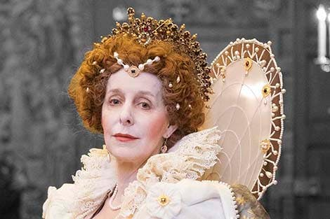 An actress dressed as Elizabeth I in the Great Watching Chamber at Hampton Court Palace.