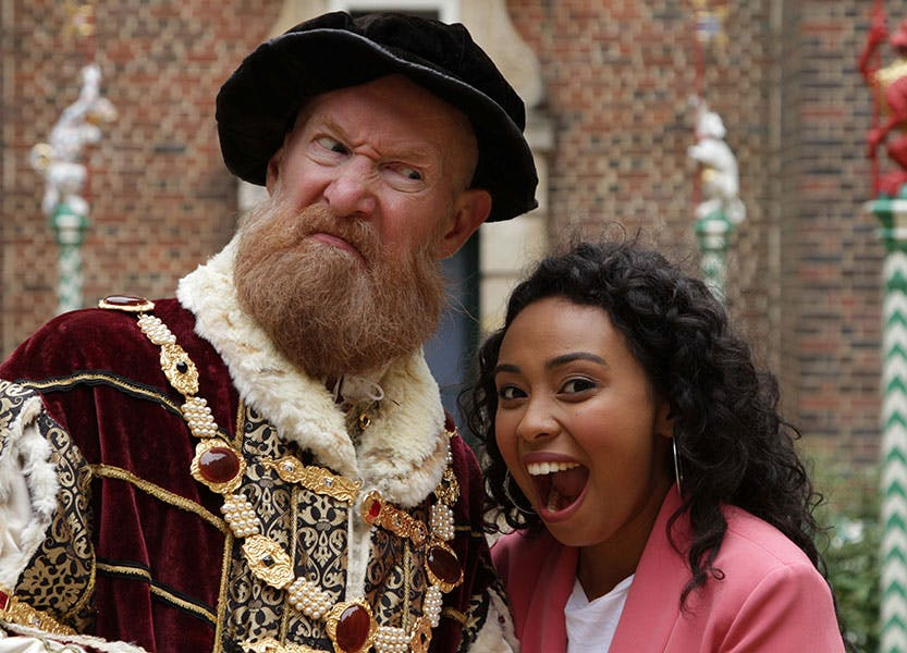 Two people, once dressed in Tudor costume.