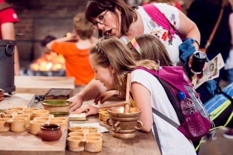 Visitors explore Henry VIII's Kitchens after re-interpretation in 2018.
