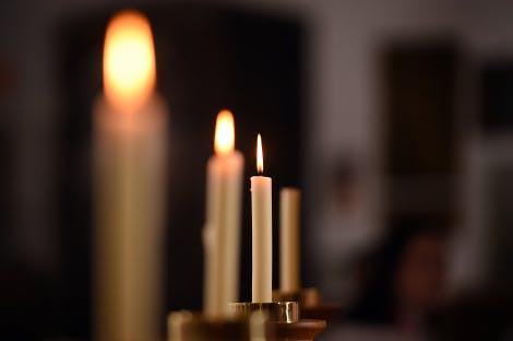 An image of candles burning