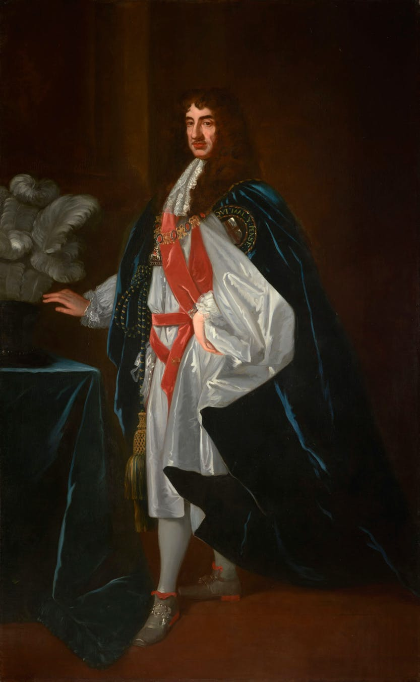 A full-length portrait of Charles II wearing Garter robes, a dark blue velvet mantle lined with white silk and embroidered with the Garter badge. He looks towards the viewer.